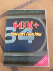 64 NIC+ ethernet network cartridge using RR-net, NET-64 or the TFE system. The cartridge has been placed in a Universal Game Case.