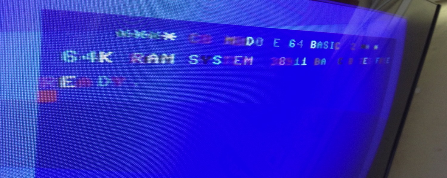 Commodore 64 assy no. 250407 Rev. B repair log with a broken PLA chip at U17