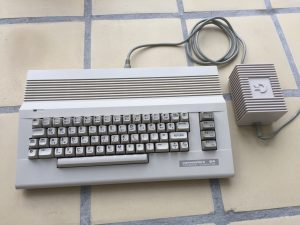 Commodore 64 modded with a Raspberry Pi 3 model B. The machine runs RetroPie with emulators for the Commodore 64. Read about the mod on breadbox64.com.