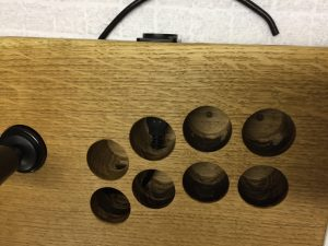 Fightstick made from a solid piece of oak wood. Internal wires. breadbox64.com