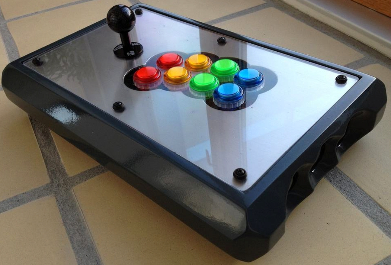 Universal fight stick for playing original arcade games, Xbox games, Commodore 64 games, Neo-Geo MVS games, Playstation games and PC games.