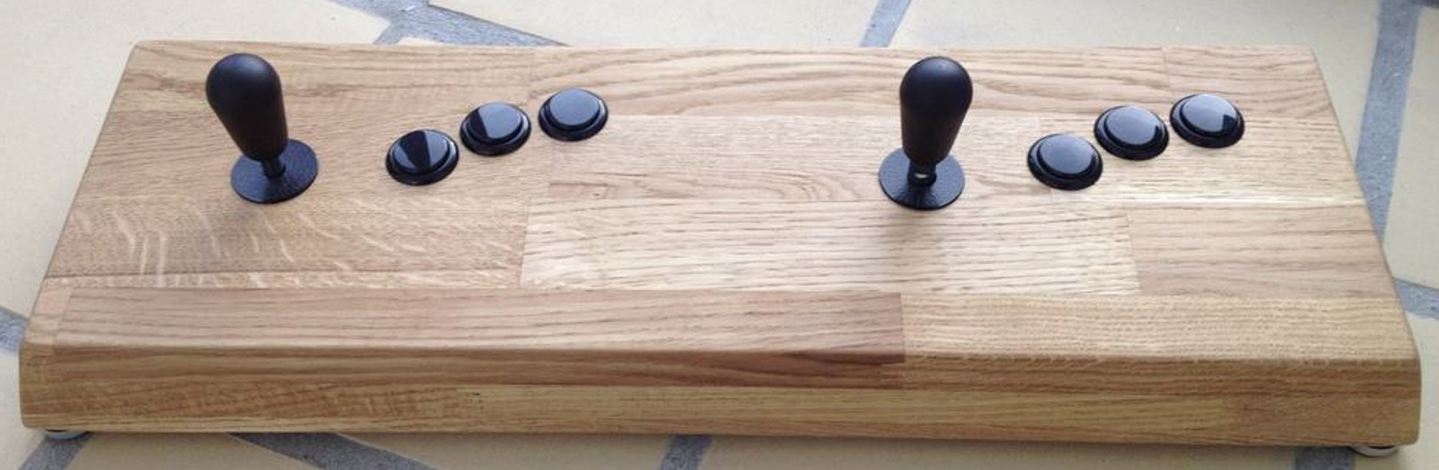 Woody fight stick II arcade fight stick made from oak wood using Seimitsu buttons and Sanwa joysticks