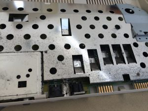 Commodore 64 Version B-3 motherboard, Assy 250466. Metal shield functions as heatsinks for all major chips. Read more on www.breadbox64.com