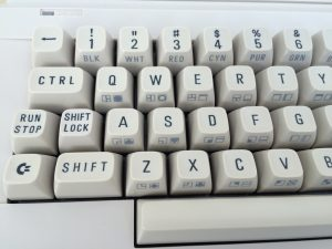 Commodore 64 Version B3 motherboard in a Commodore 64C case. Keyboard is breadbox style with text on the front of the keys but in white. See more pictures on www.Breadbox64.com