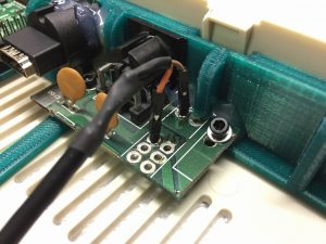 Commodore 64 raspberry pi modification. Power connector from an original C64 motherboard for powering the raspberry pi. read more on breadbox64.com.