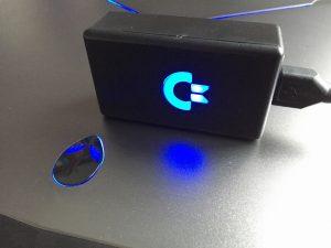 USB adapter for Commodore joysticks with blue LED logo. breadbox64.com
