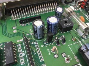 Commodore 64. Capacitor mod. breadbox64.com
